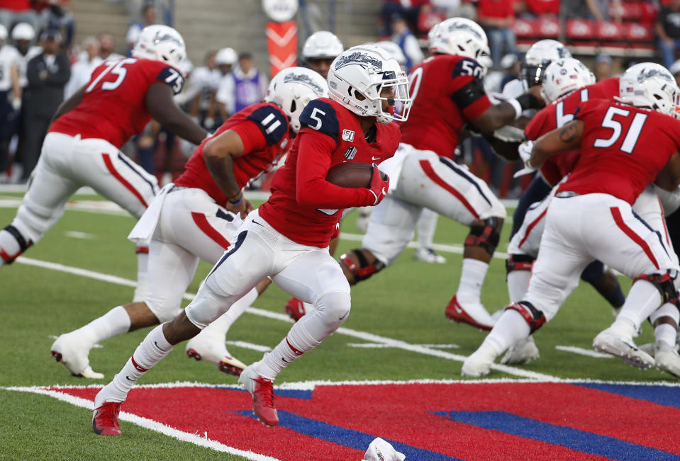 Fresno State wide receiver Jalen Cropper heads on end around against Utah State during the first half of an NCAA college football game in Fresno, Calif., Saturday, Nov. 9, 2019. (AP Photo/Gary Kazanjian)