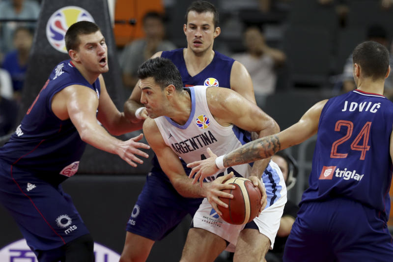Argentina's Luis Scola tries to get past Serbian defenders during a quarterfinal match for the FIBA Basketball World Cup in Dongguan in southern China's Guangdong province on Tuesday, Sept. 10, 2019. Argentina beats Serbia 97-87. (AP Photo/Ng Han Guan)