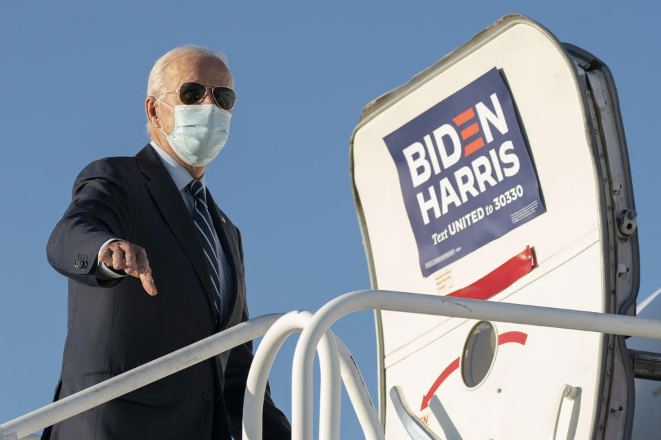 Democratic presidential candidate former Vice President Joe Biden boards his campaign plane at Raleigh-Durham International Airport in Morrisville, N.C., Sunday, Oct. 18, 2020, en route to Wilmington, Del. (AP Photo/Carolyn Kaster)
