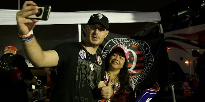'QAnon John' takes a selfie with another Trump supporter at the president's rally in Middletown, PA.