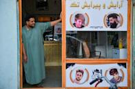 Since the Taliban swept to power in mid-August, Afghans have little cash to spare for visiting barbers and fear being punished for sporting short or fashionable cuts (AFP/Hoshang Hashimi)