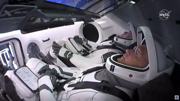 PHOTO: In this still image taken from NASA TV, NASA astronauts Bob Behnken (rear) and Doug Hurley are strapped in the SpaceX Crew Dragon capsule at Kennedy Space Center in Florida for their launch to the International Space Station on May 30, 2020. (NASA TV via AFP via Getty Images)