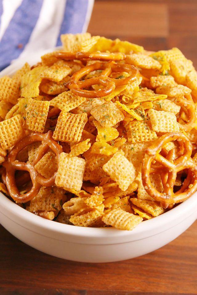 """<p>Behold, this winning combo of Corn Chex cereal, Rice Chex cereal, Cool Ranch Doritos ... and, need we say more? </p><p><a href=""""http://www.delish.com/cooking/recipe-ideas/recipes/a51150/cool-ranch-snack-mix-recipe/"""" rel=""""nofollow noopener"""" target=""""_blank"""" data-ylk=""""slk:Get the recipe from Delish »"""" class=""""link rapid-noclick-resp""""><em>Get the recipe from Delish »</em></a> </p>"""