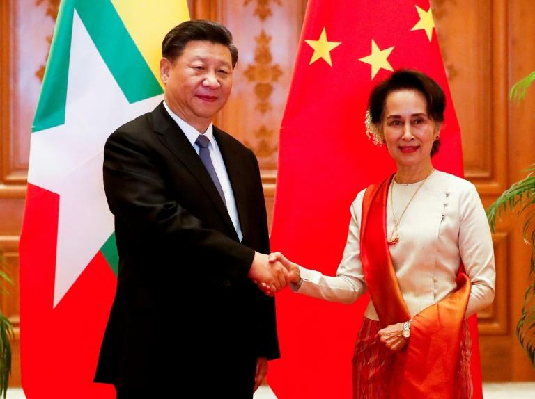 A scatalogical translation error in the name of Chinese President Xi Jinping (L) most notably appeared on the official Facebook page of Myanmar's civilian leader Aung San Suu Kyi (R) (AFP Photo/Nyein CHAN NAING)