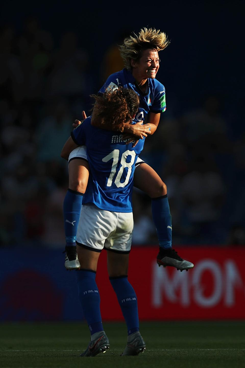 Ilaria Mauro and Valentina Giacinti of Italy celebrate following their sides victory in the 2019 FIFA Women's World Cup France Round Of 16 match between Italy and China at Stade de la Mosson on June 25, 2019 in Montpellier, France. (Photo by Naomi Baker - FIFA/FIFA via Getty Images)
