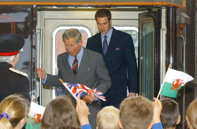 Prince William and Charles arriving at Bangor Station in 2003