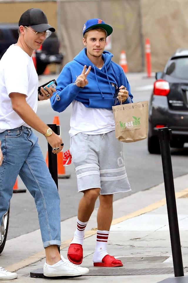 "<p>After another tumultuous week, Bieber was back at the Beverly Hills church where he <a href=""https://www.yahoo.com/celebrity/paparazzi-clipped-bieber-speaks-accidents-happen-173332810.html"" data-ylk=""slk:clipped a paparazzo;outcm:mb_qualified_link;_E:mb_qualified_link"" class=""link rapid-noclick-resp newsroom-embed-article"">clipped a paparazzo</a>. This time, the serial apologist brought a police officer and a security team with him. (Photo: BACKGRID USA) </p>"