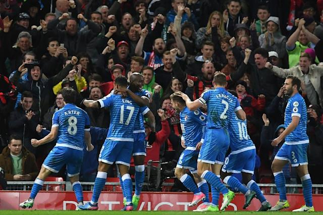 Bournemouth's striker Joshua King (2nd L) celebrates with teammates after scoring their second goal during the English Premier League football match between Liverpool and Bournemouth at Anfield in Liverpool, north west England on April 5, 2017 (AFP Photo/Paul ELLIS)