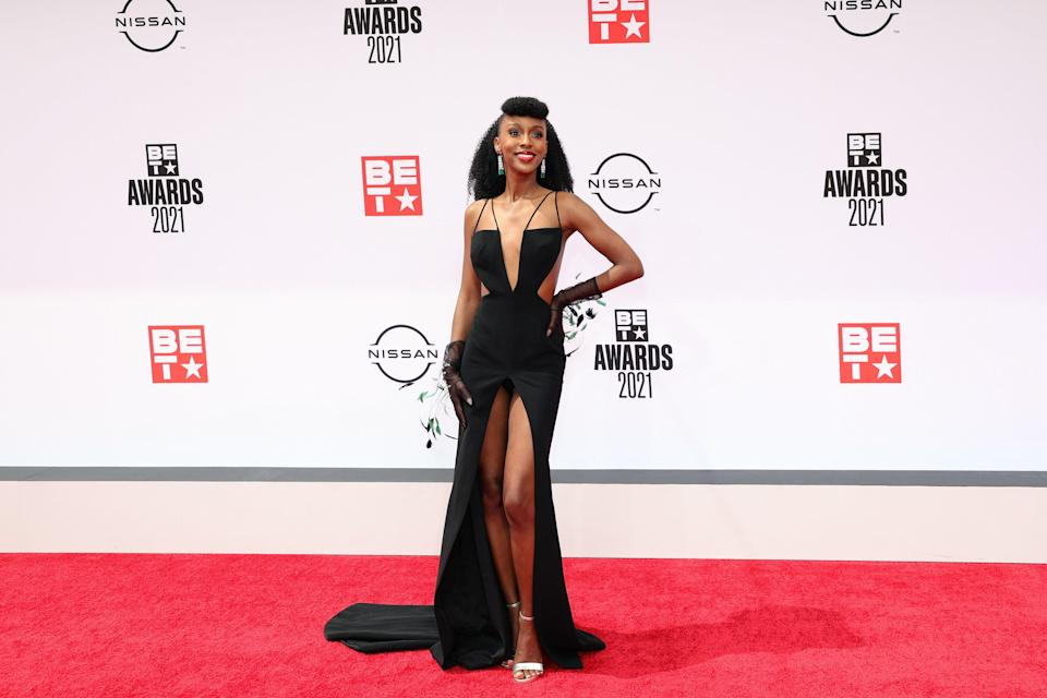 Ebony Obsidian showed up to the party wearing a strappy Mikael D gown and black sheer gloves.