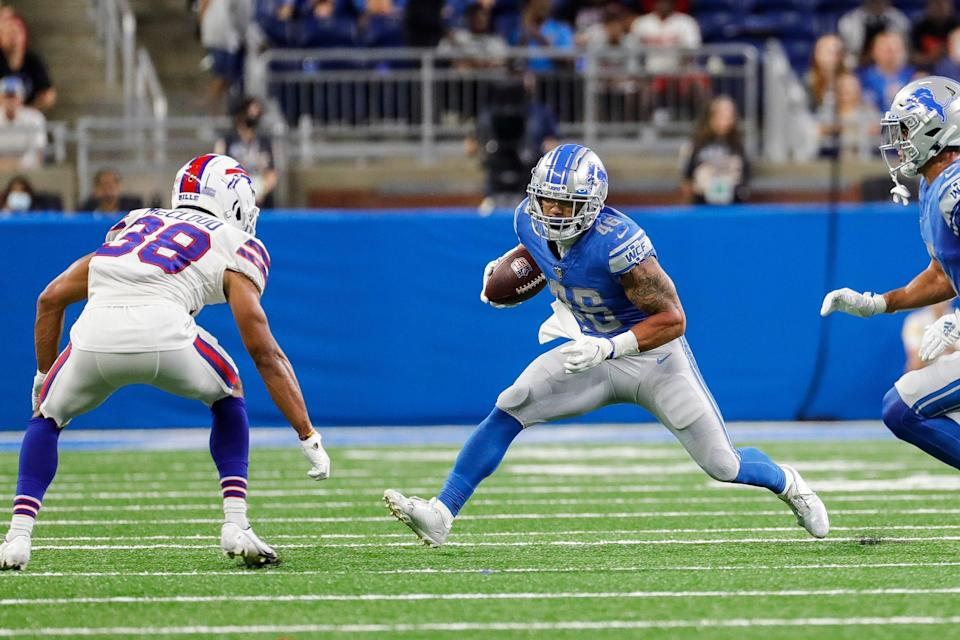 Detroit Lions running back Craig Reynolds  (46) runs against Buffalo Bills cornerback Nick McCloud (38) during the second half of the preseason game at Ford Field in Detroit on Friday, Aug. 13, 2021.