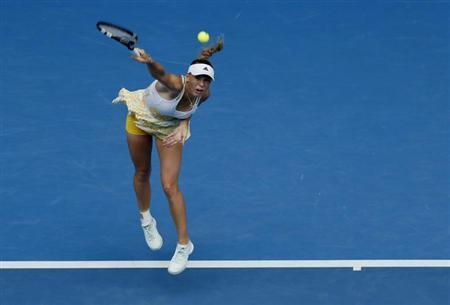 Caroline Wozniacki of Denmark serves to Garbine Muguruza of Spain during their women's singles match at the Australian Open 2014 tennis tournament in Melbourne January 18, 2014. REUTERS/Brandon Malone