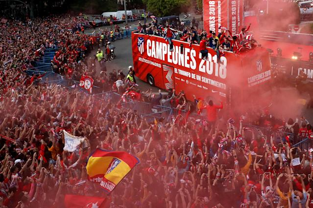 Soccer Football - Atletico Madrid Celebrate Winning The Europa League - Neptuno Square, Madrid, Spain - May 18, 2018 Atletico Madrid players on the open top bus during the victory parade REUTERS/Juan Medina