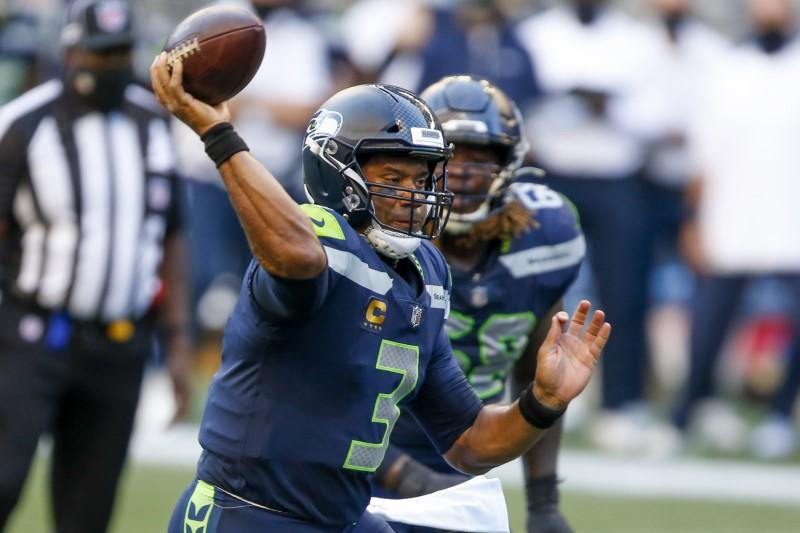 NFL roundup: Wilson tosses five touchdowns as Seahawks outlast Pats