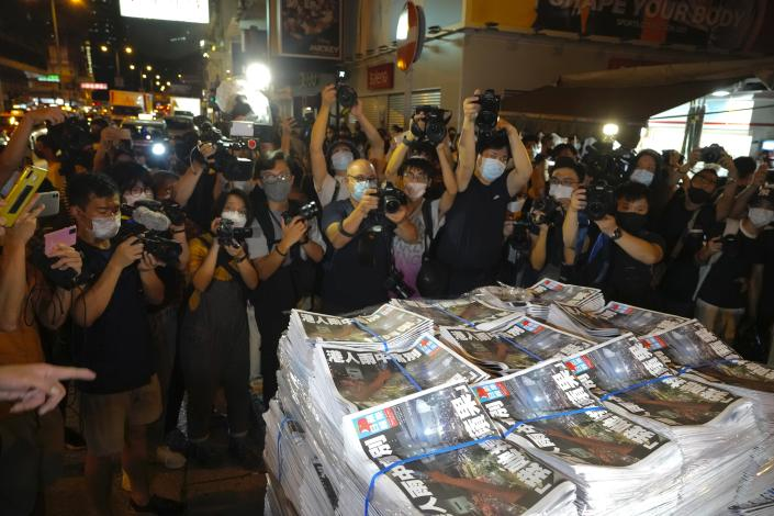 Last issue of Apple Daily arrive at a newspaper booth in Hong Kong, early Thursday, June 24, 2021. Hong Kong's pro-democracy Apple Daily newspaper will stop publishing Thursday, following last week's arrest of five editors and executives and the freezing of $2.3 million in assets under the city's year-old national security law. (AP Photo/Vincent Yu)