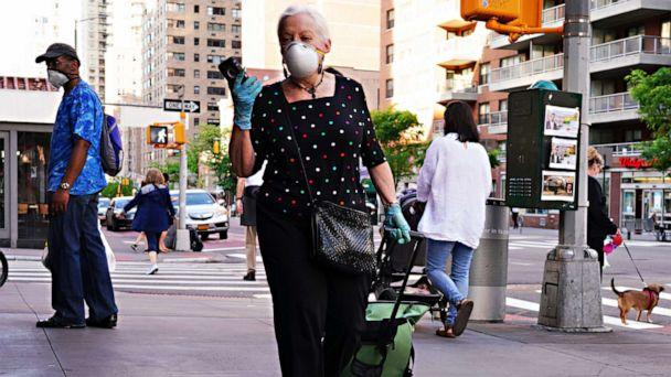 PHOTO: A woman walks while wearing a protective mask during the coronavirus pandemic, May 16, 2020 in New York City. (Cindy Ord/Getty Images)