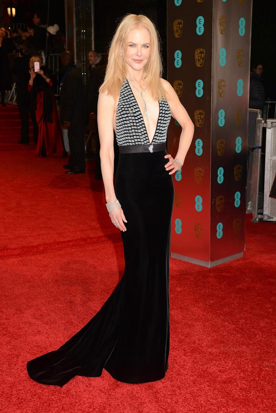 <p>Nicole opted for a halterneck Armani design with a gorgeous velvet skirt. <i>[Photo: Getty]</i> </p>
