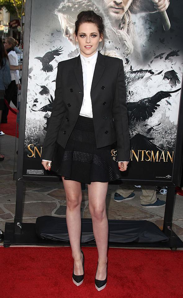 "Kristen Stewart rocked an equestrian-like look upon arriving at a <a target=""_blank"" href=""http://movies.yahoo.com/movie/snow-white-and-the-huntsman/"">""Snow White and the Huntsman""</a> industry screening in L.A. on Tuesday night. The 22-year-old actress -- who was outfitted by designer Stella McCartney -- paired a high-collar blouse with a black blazer and matching mini skirt. A loose updo, smokey eye makeup, and two-tone platform pumps completed her youthful yet chic ensemble. (5/29/2012)<br><br><a target=""_blank"" href=""http://bit.ly/lifeontheMlist"">Follow 2 Hot 2 Handle creator, Matt Whitfield, on Twitter!</a>"