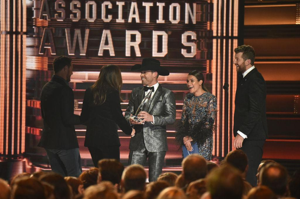 <p>Singer-songwriter Dustin Lynch, actress Lea Michele and singer Brett Eldredge present an award onstage during the 51st annual CMA Awards at the Bridgestone Arena on November 8, 2017 in Nashville, Tennessee. (Photo by John Shearer/WireImage) </p>