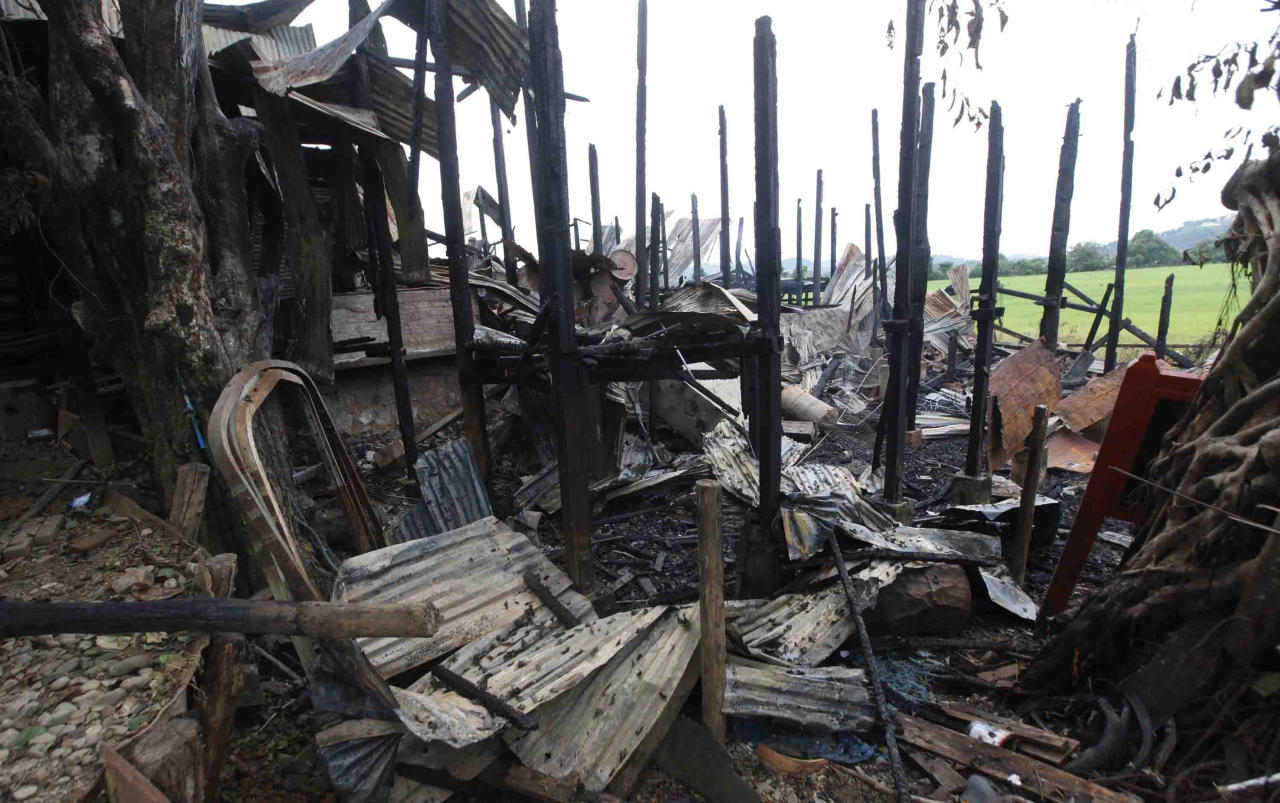 Blackened pillars stand among debris of a burnt building Wednesday, Oct. 2, 2013, in Thandwe, Rakhine State, western Myanmar. Terrified Muslim families hid in forests in western Myanmar on Wednesday, one day after rampaging Buddhist mobs killed a 94-year-old woman and burned dozens of homes despite the first trip to the volatile region by President Thein Sein since unrest erupted last year. The violence near Thandwe, a coastal town the president was due to visit later Wednesday on the second day of his tour of Rakhine state, raised new questions about government's failure to curb anti-Muslim attacks and or protect the embattled minority. (AP Photo/Khin Maung Win)
