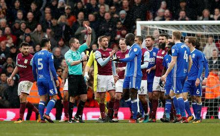 Soccer Football - Championship - Aston Villa vs Birmingham City - VIlla Park, Birmingham, Britain - February 11, 2018 Birmingham's Cheikh NDoye is shown a second yellow card and then a red card by referee Peter Bankes Action Images/Andrew Boyers