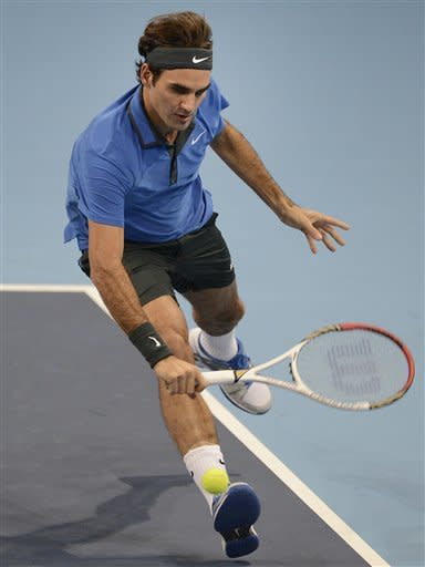 Switzerland's Roger Federer returns a ball to Argentina's Juan Martin Del Potro during their final match at the Swiss Indoors tennis tournament at the St. Jakobshalle in Basel, Switzerland, on Sunday, Oct. 28, 2012. (AP Photo/Keystone/Georgios Kefalas)