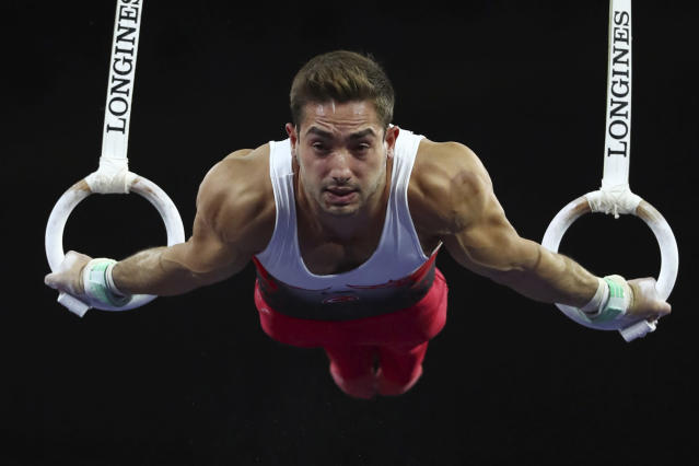 Gold medalist Ibrahim Colak of Turkey performs on the rings in the men's apparatus finals at the Gymnastics World Championships in Stuttgart, Germany, Saturday, Oct. 12, 2019. (AP Photo/Matthias Schrader)
