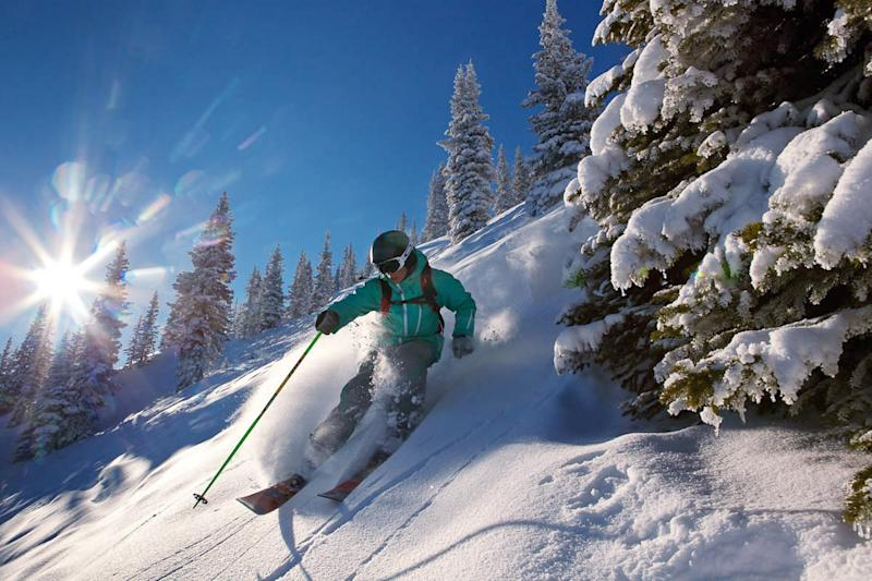 This Dec. 15, 2011 photo provided by Colorado Ski Country USA shows a skier making his way down the slopes in Aspen, Colo. A disappointing snow year in much of Colorado ski country last season has the state's resorts and hotels hoping that snowboarders and skiers will burn off some pent-up demand for deep snow this winter. (AP Photo/Colorado Ski Country USA/Jeremy Swanson)