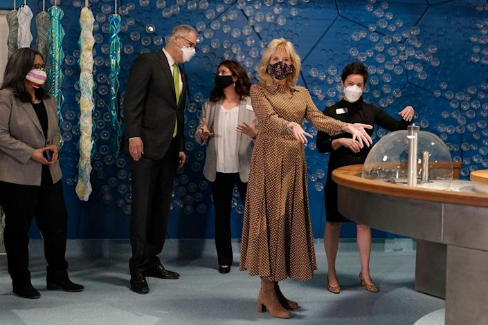 <p>While visiting the new children's museum at Joint Base Lewis-McChord, Dr. Biden wore a brown and white polka dot shirtdress and brown suede boots. </p>