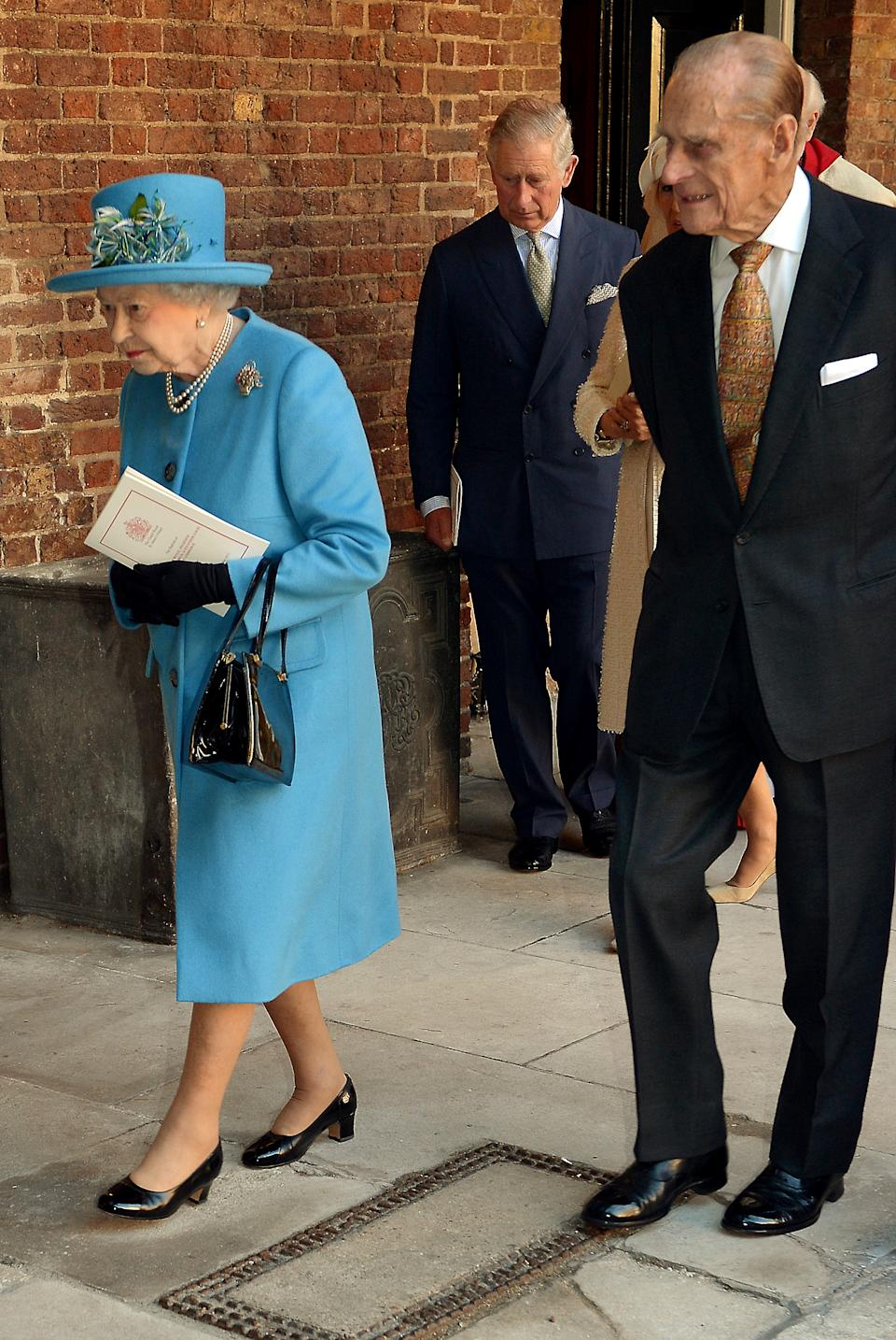 Prince Philip and the Queen are pictured at Prince George's christening in 2013. [Photo: Getty Images]