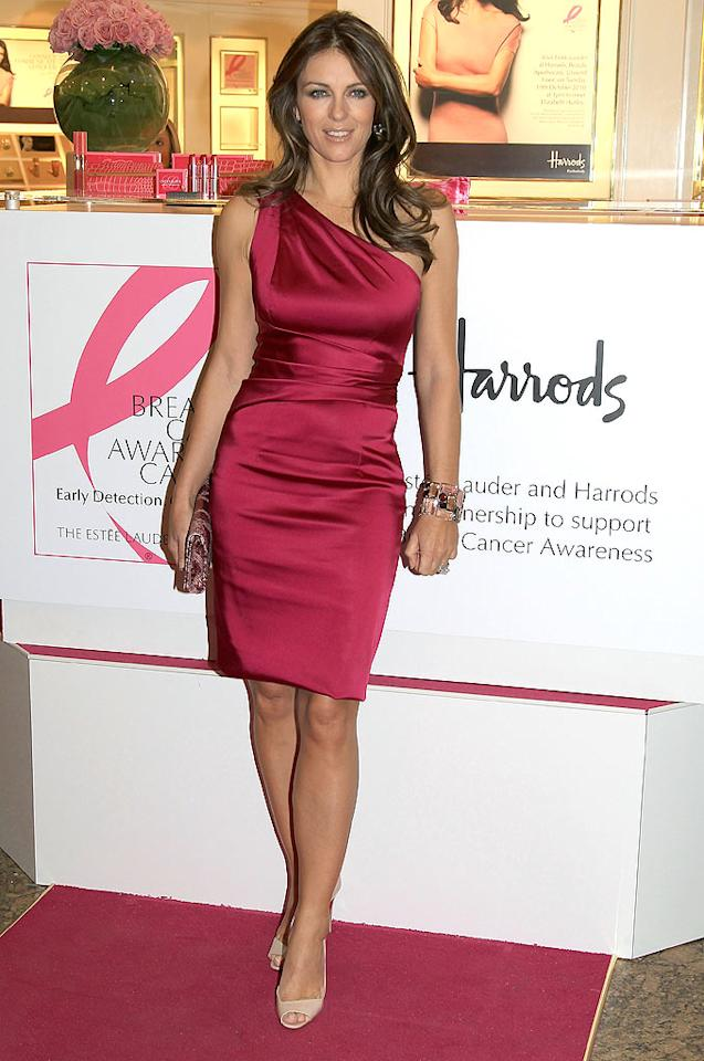 "Another fan of the asymmetrical look ... Liz Hurley, who posed for photographs during a breast cancer awareness function in a fabulously fitted, cranberry-colored frock, chunky cuff, and nude peep-toes. Chris Jackson/<a href=""http://www.gettyimages.com/"" target=""new"">GettyImages.com</a> - October 19, 2010"