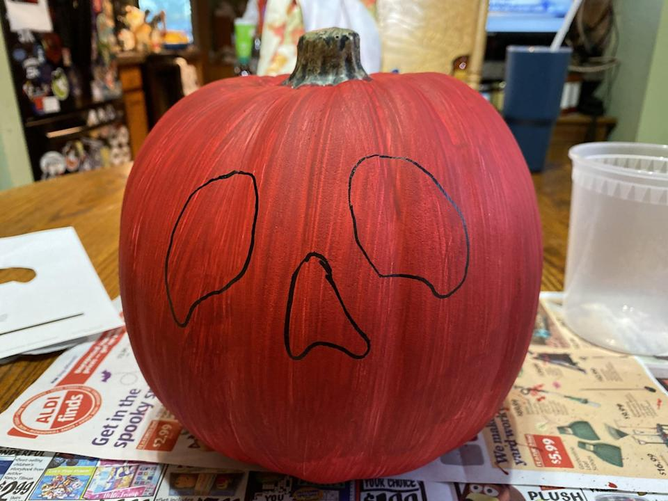"""<p>You can either free-hand the eyes and nose from the poison apple or you can <a href=""""https://disneyparks.disney.go.com/blog/2020/10/disneymagicmoments-how-to-create-a-wickedly-wild-poison-apple-pumpkin/?CMP=SOC-DPFY21Q1wo1001200029A"""" class=""""link rapid-noclick-resp"""" rel=""""nofollow noopener"""" target=""""_blank"""" data-ylk=""""slk:print the stencil"""">print the stencil</a> from the Disney Parks Blog website. I chose to use the stencil so I didn't mess anything up.</p>"""