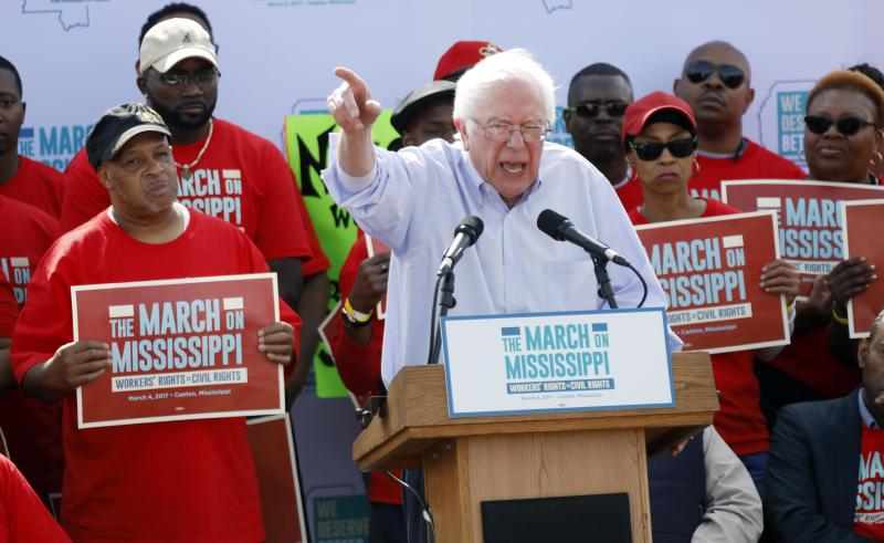 """U.S. Sen. Bernie Sanders, I-Vt, tells thousands at a pro-union rally near Nissan Motor Co.'s Canton, Miss., plant, Saturday, March 4, 2017, that he congratulates workers for their courage """"in standing up for justice."""" Among the participants were actor Danny Glover, national NAACP President Cornell Brooks, U.S. Rep. Bennie Thompson, D-Miss., and UAW president Dennis Williams. (AP Photo/Rogelio V. Solis)"""