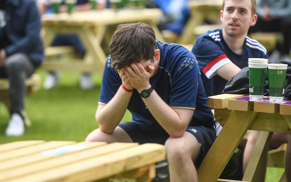 Scotland fans react while watching the match at a public viewing outside the stadium on June 14, 2021 in Glasgow - Peter Summers/Getty Images