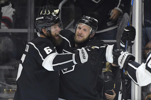 Los Angeles Kings left wing Kyle Clifford, right, celebrates his goal with defenseman Jake Muzzin during the second period of an NHL hockey game against the New Jersey Devils on Thursday, Dec. 6, 2018, in Los Angeles. (AP Photo/Mark J. Terrill)