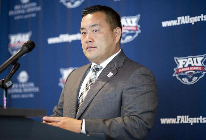 Florida Atlantic athletic director Patrick Chun talks during a news conference about football coach Carl Pelini resigning Wednesday, Oct. 30, 2013, in Boca Raton, Fla. Pelini resigned after acknowledging to school officials that he used illegal drugs. Defensive coordinator Pete Rekstis also resigned after a post-practice meeting with athletic director Chun, who says school officials received word about the matter earlier this week. (AP Photo/J Pat Carter)