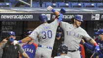 Texas Rangers' Nate Lowe (30) celebrates his solo home run off Tampa Bay Rays starter Josh Fleming with Jonah Heim, right, during the second inning of a baseball game Wednesday, April 14, 2021, in St. Petersburg, Fla. (AP Photo/Steve Nesius)