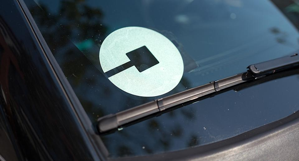Logo for car-sharing company Uber on the passenger side windshield of a vehicle in the South of Market (SoMa) neighborhood of San Francisco, California, October 13, 2017. SoMa is known for having one of the highest concentrations of technology companies and startups of any region worldwide. (Photo by Smith Collection/Gado/Sipa USA)