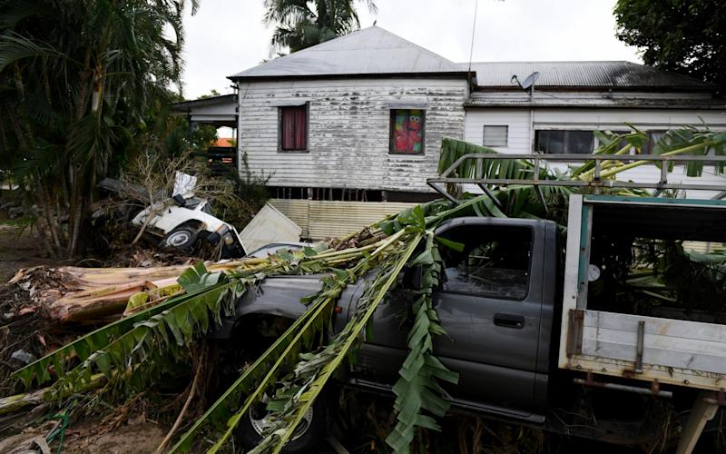 Cars and banana trees are washed up alongside a house on the Tweed River in Murwillumbah, New South Wales, Australia, 03 April 2017 - Credit: TRACEY NEARMY/AAP