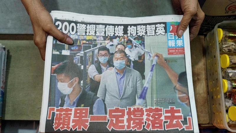 Hong Kongers defy China, rush to buy pro-democracy newspaper after owner's arrest
