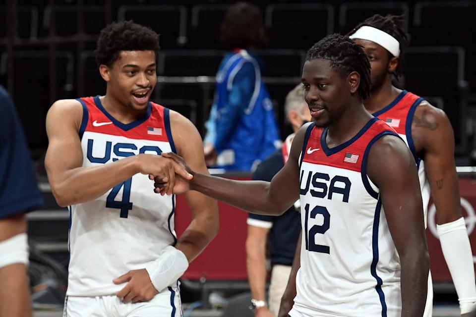 Pictured here, USA's Keldon Johnson (L) and Jrue Holiday (R) celebrate their victory against the Boomers.