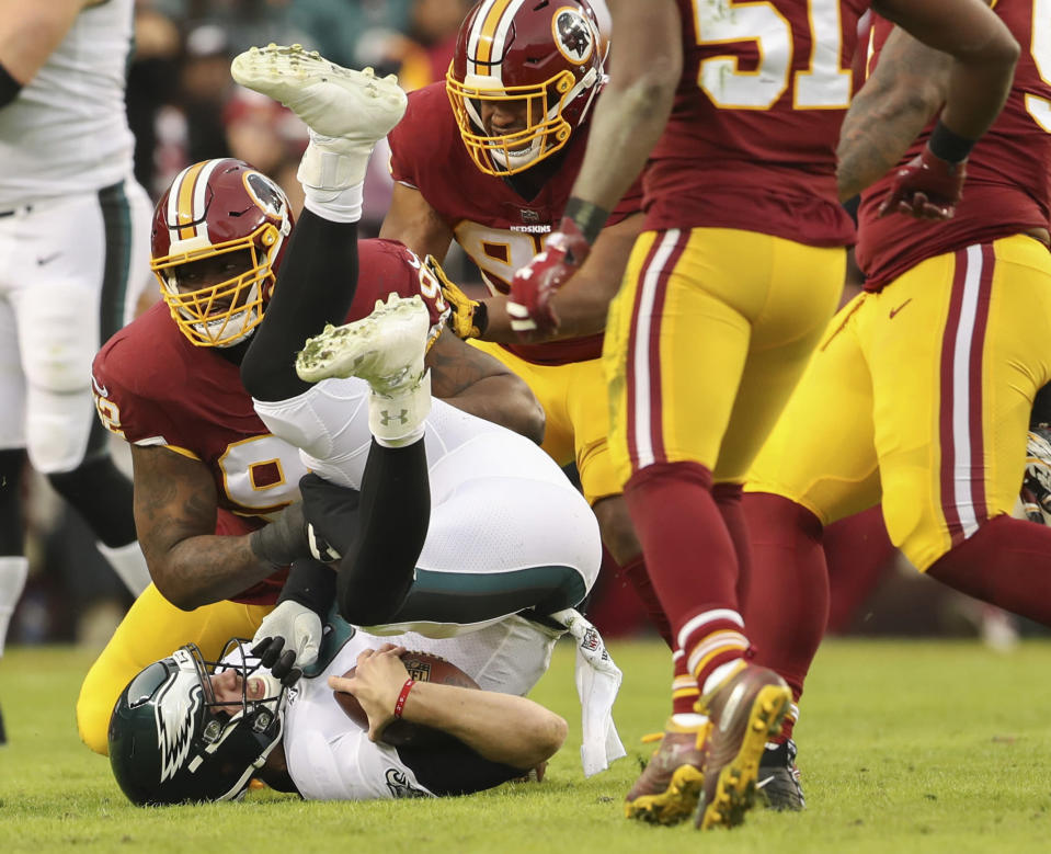 FILE - In this Sunday, Dec. 30, 2018, file photo, Washington Redskins defensive tackle Stacy McGee (92) sacks Philadelphia Eagles quarterback Nick Foles (9) during the first half of the NFL football game, in Landover, Md. On Wednesday, March 13, 2019, the Redskins released linebacker Zach Brown and defensive lineman Stacy McGee as part of a remaking of their defense. (AP Photo/Andrew Harnik, File)