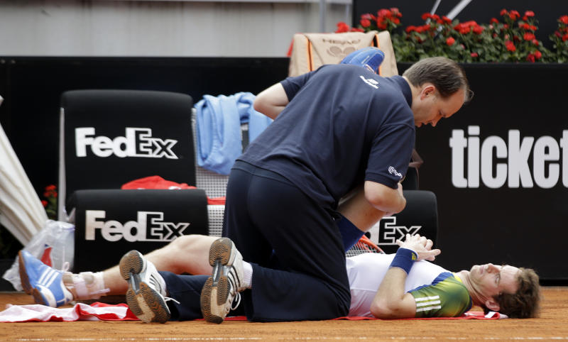Britain's Andy Murray receives medical care during his match with Spain's Marcel Granollers, at the Italian Open tennis tournament in Rome, Wednesday, May 15, 2013. Murray has retired from his second-round match with Marcel Granollers in the second round of the Italian Open. (AP Photo/Andrew Medichini)