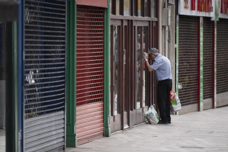 CARDIFF, UNITED KINGDOM - MAY 21: A man looks in the window of a closed coffee shop during the coronavirus lockdown period on May 21, 2020 in Cardiff, United Kingdom. The British government has started easing the lockdown it imposed two months ago to curb the spread of Covid-19, abandoning its 'stay at home' slogan in favour of a message to 'be alert', but UK countries have varied in their approaches to relaxing quarantine measures. (Photo by Matthew Horwood/Getty Images)