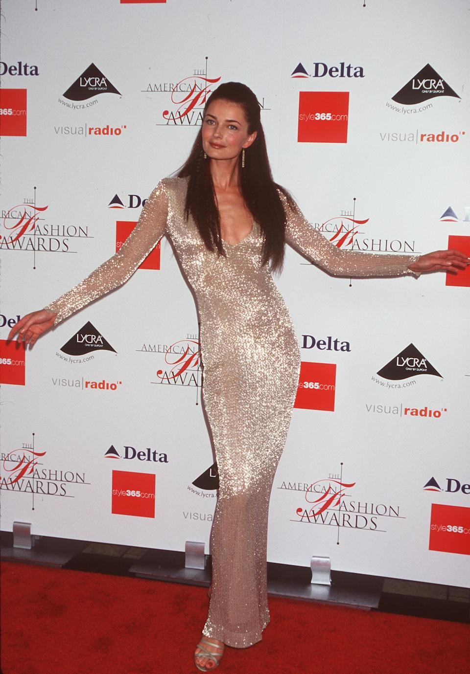 Model Paulina Porizkova wearing a long gold dress on the red carpet at the Council of Fashion Designers of America (CFDA) Awards at Avery Fisher Hall June 15, 2000 in New York City
