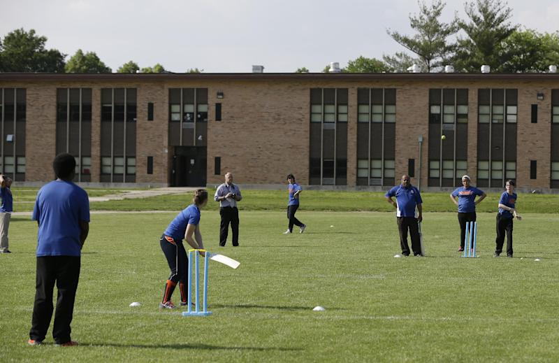 Students from Indianapolis Public Schools' Gambold Prep High School play a cricket match Thursday, May 16, 2013, in Indianapolis. Indianapolis is spending $6 million to equip one of its parks with a premier cricket field, known as a pitch, and space for Gaelic football, rugby, hurling and other sports mainly popular overseas. Mayor Greg Ballard hopes his World Sports Park project brings international exposure to Indiana's capital and helps local companies attract talented overseas workers by offering them a home for their favorite games. (AP Photo/Darron Cummings)