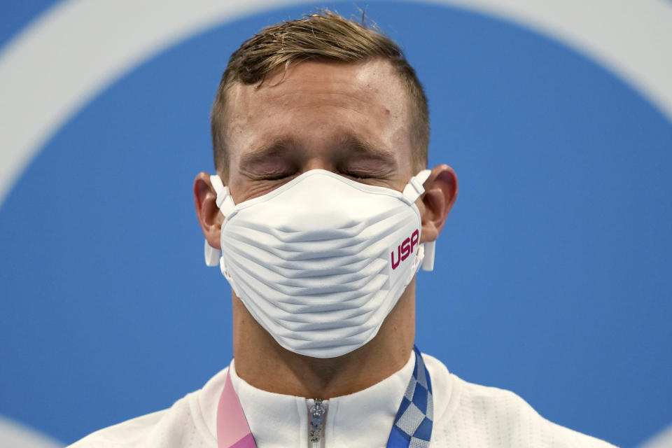 Caeleb Dressel of the United States closes his eyes on the podium after receiving his gold medal for the men's 100-meter freestyle at the 2020 Summer Olympics, Thursday, July 29, 2021, in Tokyo, Japan. (AP Photo/Matthias Schrader)