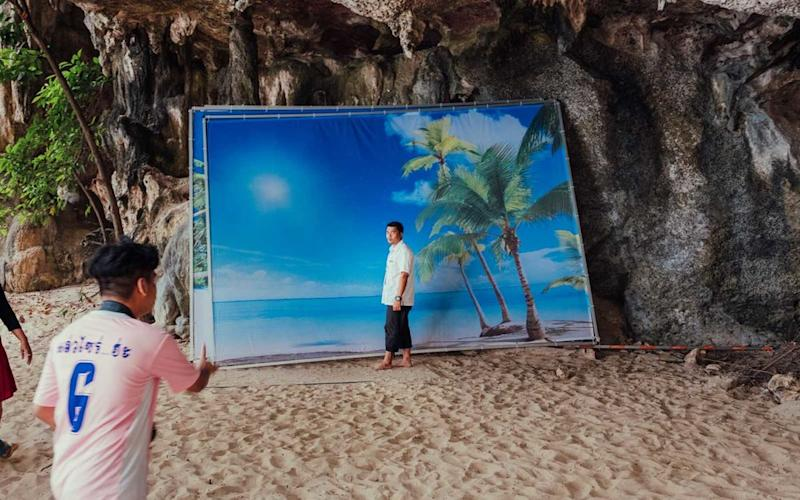 A man poses in front of a backdrop at Railay Beach, Krabi. | Stan Nalewski