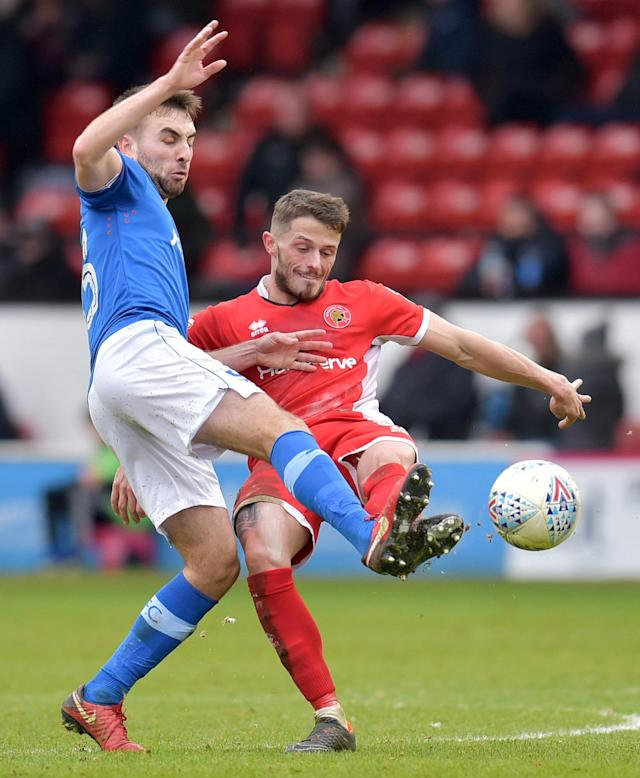 "Soccer Football - League One - Walsall vs Portsmouth - The Banks's Stadium, Walsall, Britain - March 31, 2018 Walsall's Flo Cuvelier in action with Portsmouth's Ben Close Action Images/Paul Burrows EDITORIAL USE ONLY. No use with unauthorized audio, video, data, fixture lists, club/league logos or ""live"" services. Online in-match use limited to 75 images, no video emulation. No use in betting, games or single club/league/player publications. Please contact your account representative for further details."