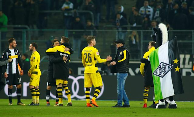Soccer Football - Bundesliga - Borussia Moenchengladbach vs Borussia Dortmund - Borussia-Park, Moenchengladbach, Germany - February 18, 2018 Borussia Dortmund coach Peter Stoeger celebrates after the match with Lukasz Piszczek and teammates REUTERS/Thilo Schmuelgen DFL RULES TO LIMIT THE ONLINE USAGE DURING MATCH TIME TO 15 PICTURES PER GAME. IMAGE SEQUENCES TO SIMULATE VIDEO IS NOT ALLOWED AT ANY TIME. FOR FURTHER QUERIES PLEASE CONTACT DFL DIRECTLY AT + 49 69 650050