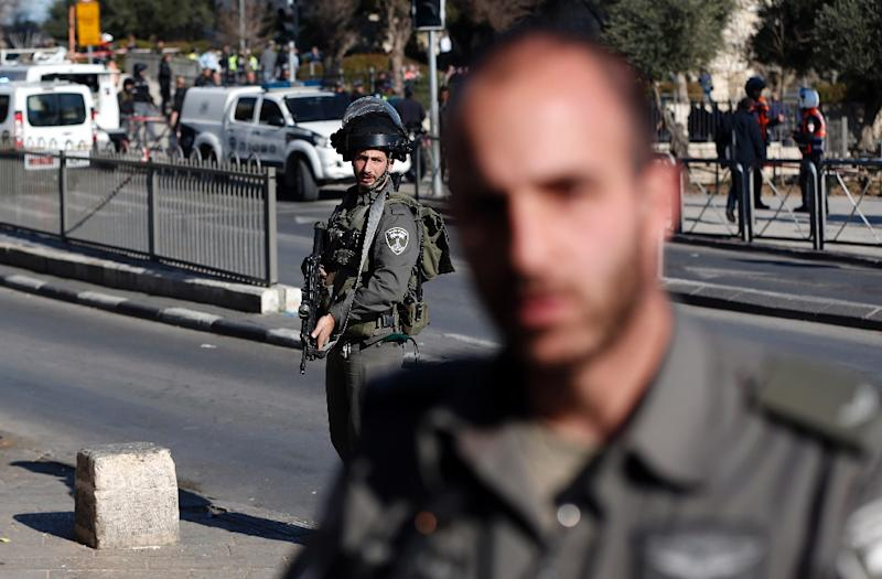 Israeli police patrol following an attack by three Palestinians at Damascus Gate, a main entrance to Jerusalem's Old City, on February 3, 2016 (AFP Photo/Ahmad Gharabli)
